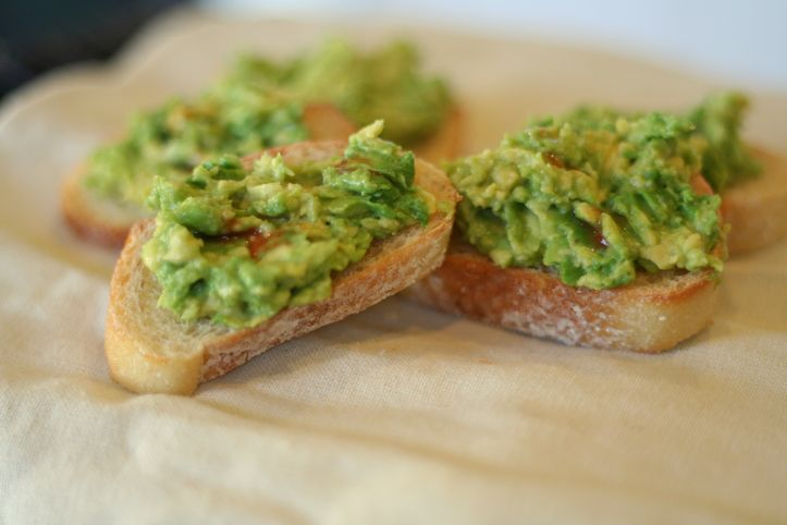spicy smashed avocados on butter grilled toast