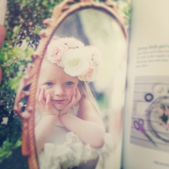 Love seeing my little one in print.  This wasn't even one of the official photos... she was just caught looking at herself in the mirror and they decided to use it in the book.