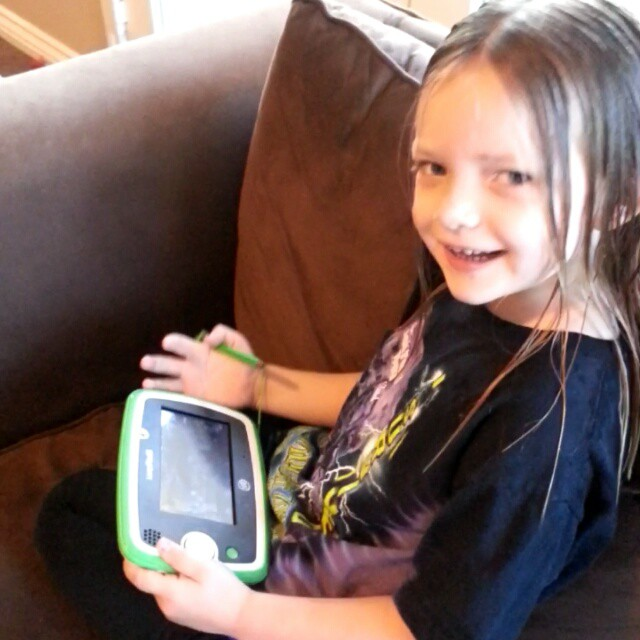 She got up early today to play with her @leapfrog #LeapPad3 before school and is sharing her favorite thing to do on it! #ad #BeachesMoms