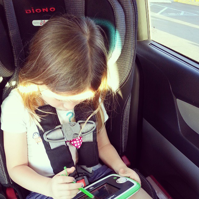 Deep concentration happening here. So thankful to have her #LeapPad3 here to entertain her while we wait for a jump start.  I can't remember ever having a dead battery before and @leapfrogofficial is making this experience so much better for my little one. #ad