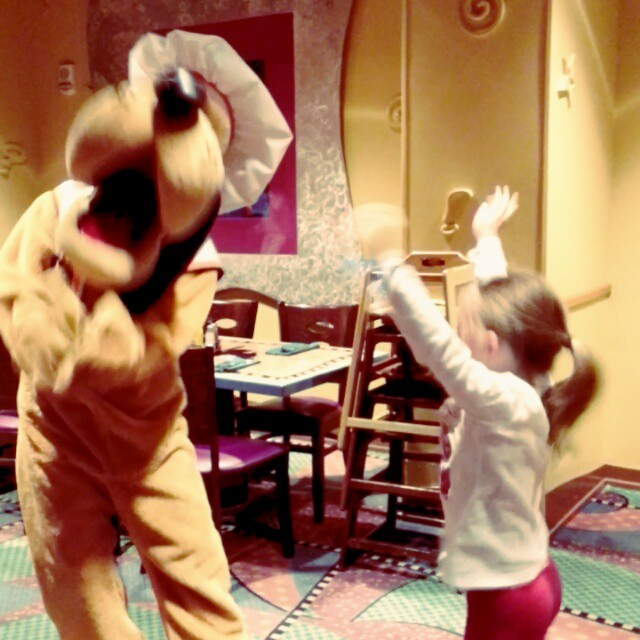 At our favorite place for dinner! Where else can you dance with Pluto? #disneyholidays #GoofysKitchen