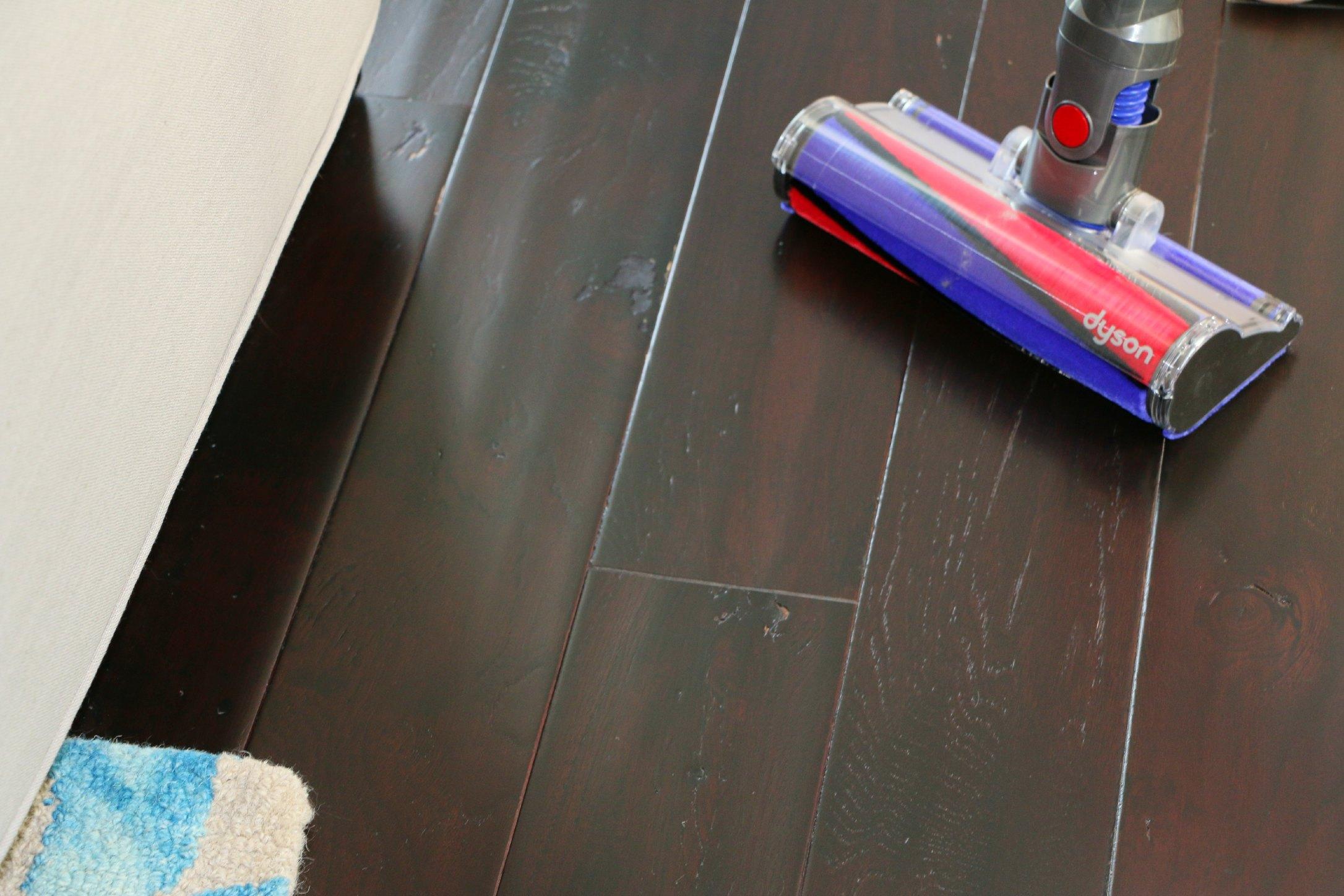 dyson stick vacuum on hardwood floors