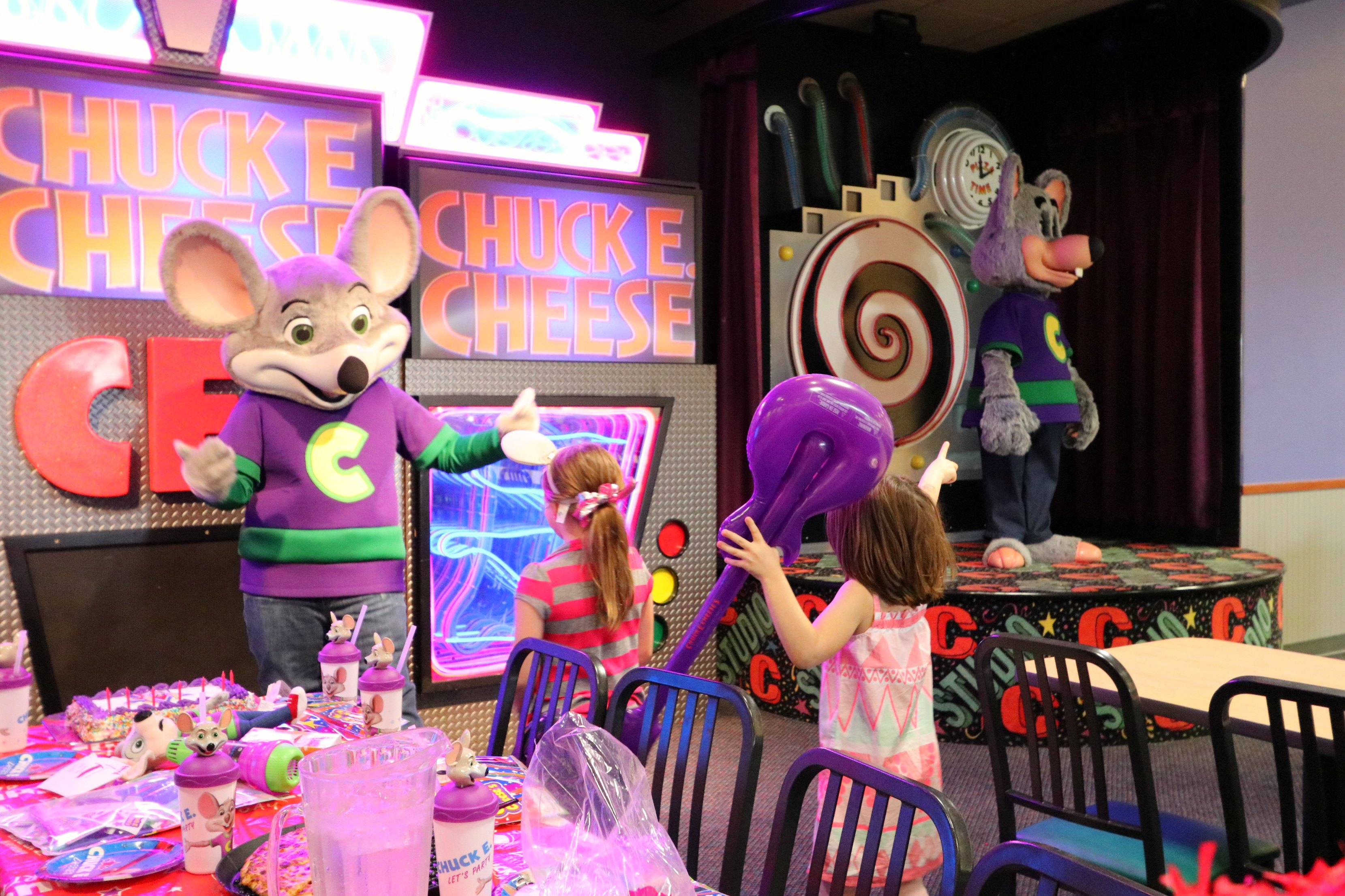 Chuck E. Cheese's (formerly Chuck E. Cheese's Pizza Time Theatre, and Chuck E. Cheese's Pizza) is a chain of American family entertainment centers and restaurants. The chain is the primary brand of CEC Entertainment, Inc. and is headquartered in Irving, Texas. The establishment serves pizza and other menu items, complemented by arcade games, amusement rides, and animatronic displays as a focus.