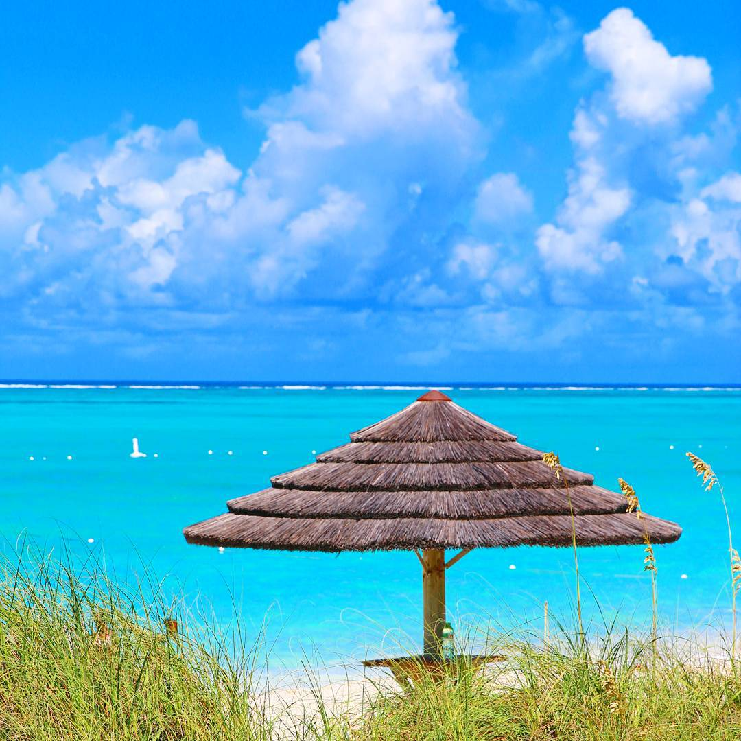 It's all about the blue. Blue water and blue skies. We are planning our next island adventure. Do  you have a favorite island? #islandlife #turksandcaicos #vacation #familytrip #providenciales #gracebaybeach #familytravel #carribean