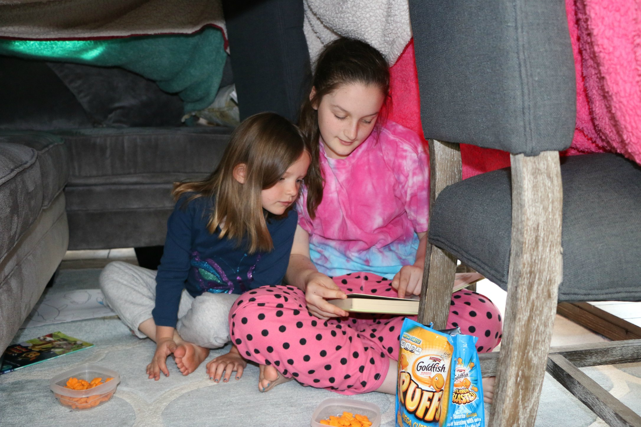 reading in a fort tent