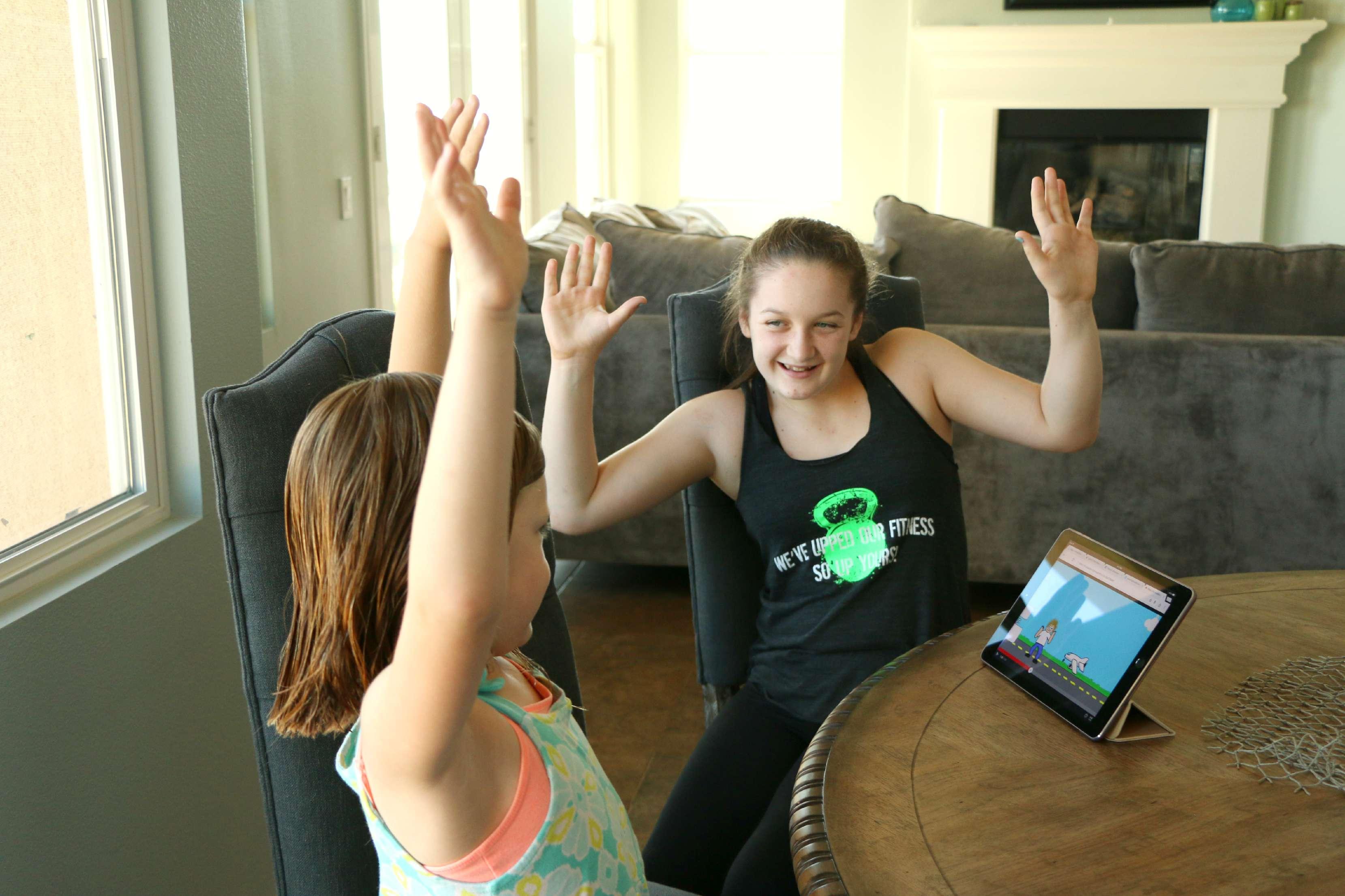 kids dancing to pop ups