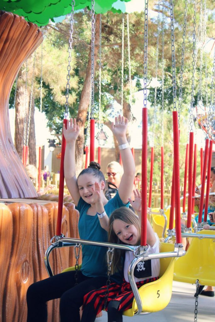 ashley-and-emily-on-the-swings-in-camp-spooky