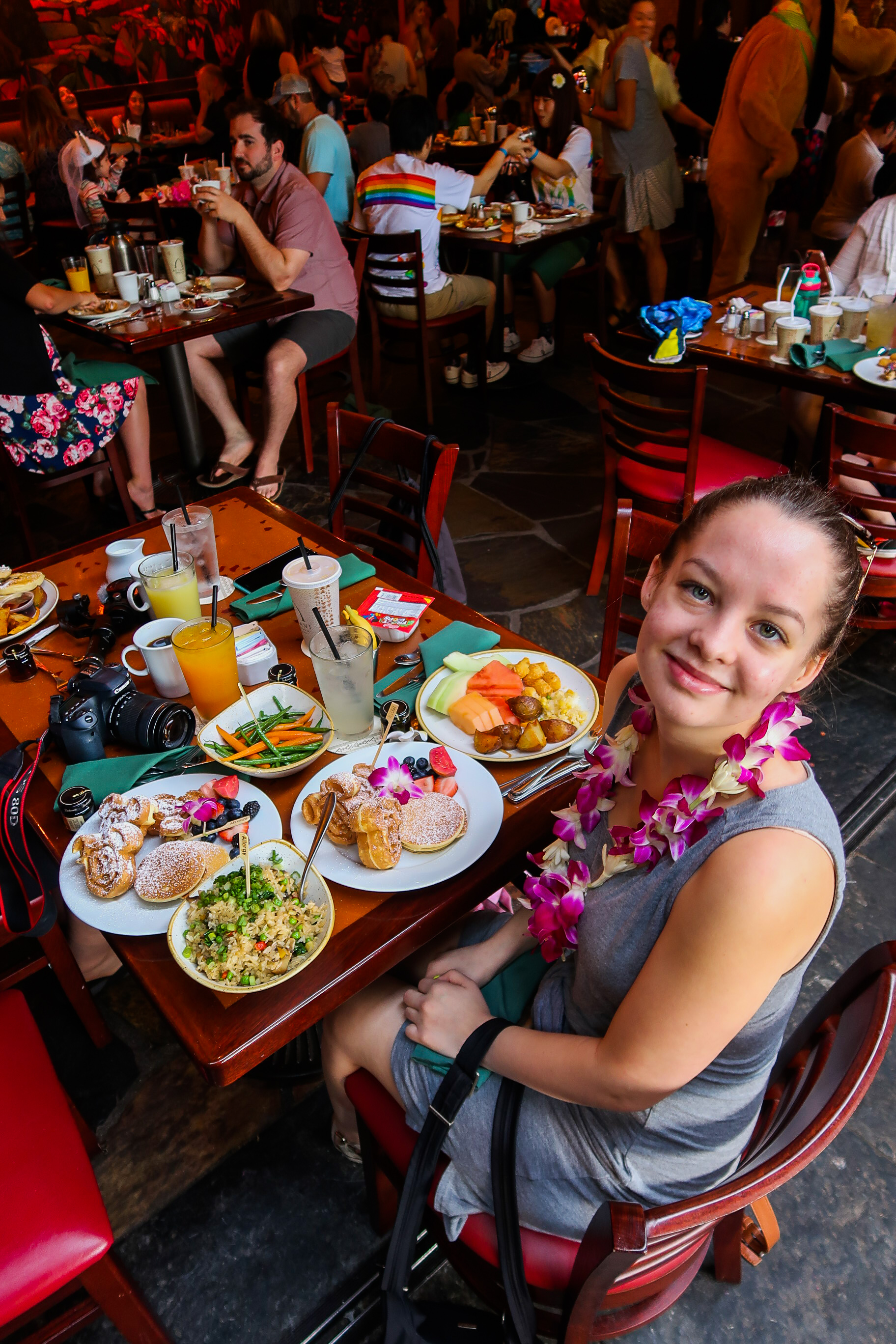 Girl enjoying vegan breakfast at the breakfast buffet at Disney's Aulani
