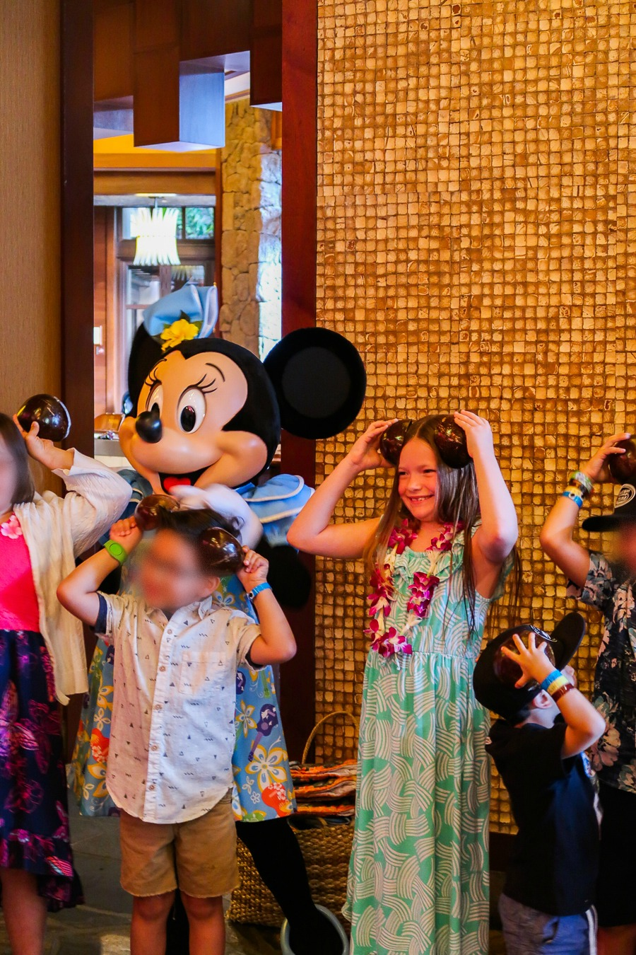 Girl celebrating with Minnie Mouse at Disney's Aulani
