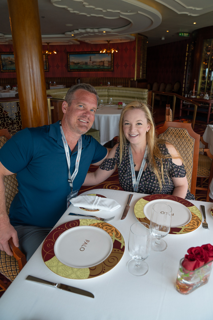 Husband and wife sitting at the table during Palo Brunch on the Disney Dream