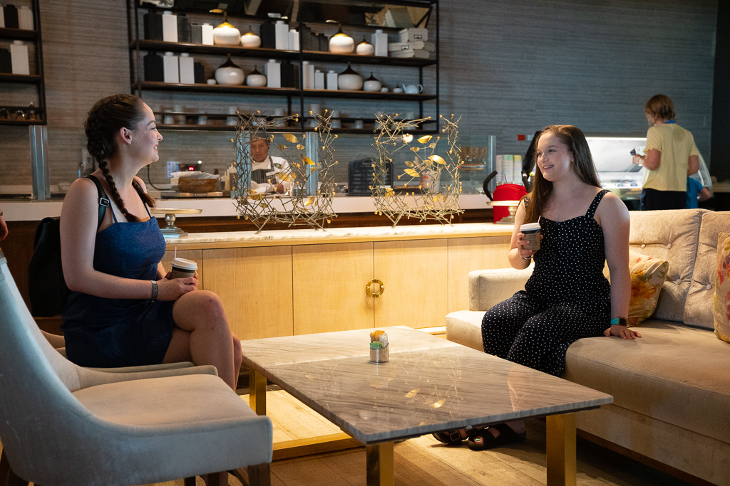 Two teens girls enjoying coffee at the coffee bar at the Grand at Moon Palace Cancun