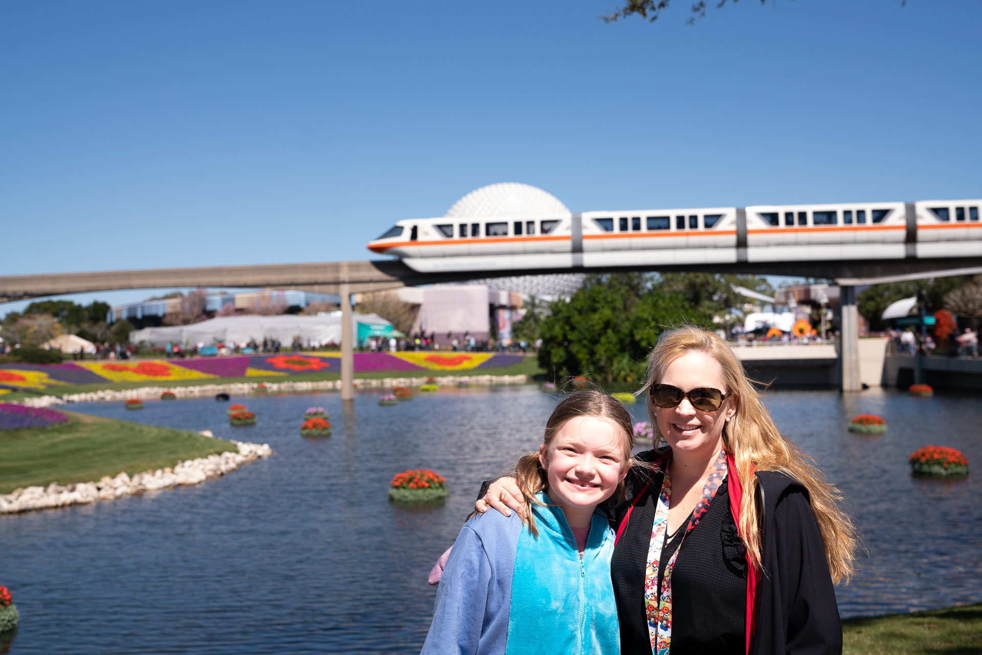 Mother and daughter in front of the monorail in Epcot at Walt Disney World