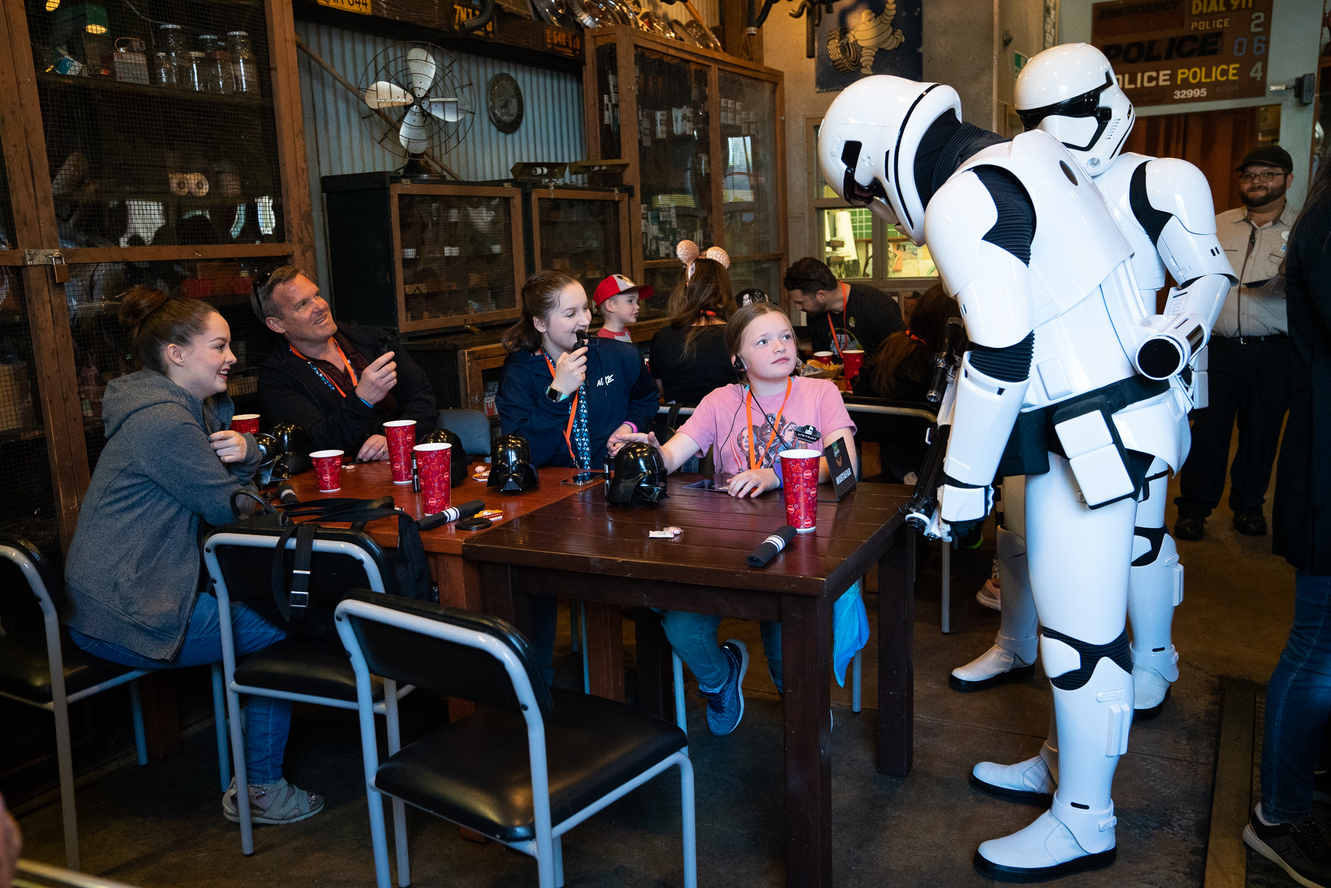 Family receiving a visit from Stormtroopers during a lunch break while on a VIP Star Wars tour at Disney's Hollywood Studios at Walt Disney World