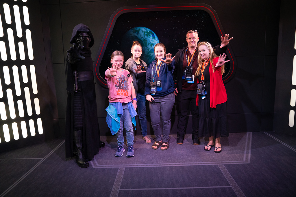 Family posing with Kylo Ren while on a VIP Star Wars Tour at Disney's Hollywood Studios at Walt Disney World