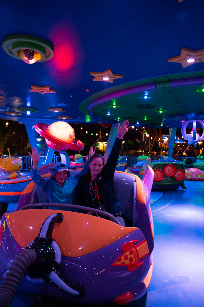 Two girls in the Alien Swirling Saucers in Toy Story Land at Disney's Hollywood Studios at Walt Disney World