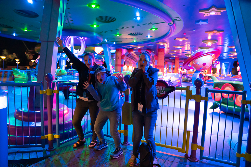 Three girls at the Alien Spinning Saucers in Toy Story Land at Disney's Hollywood Studios at Walt Disney World