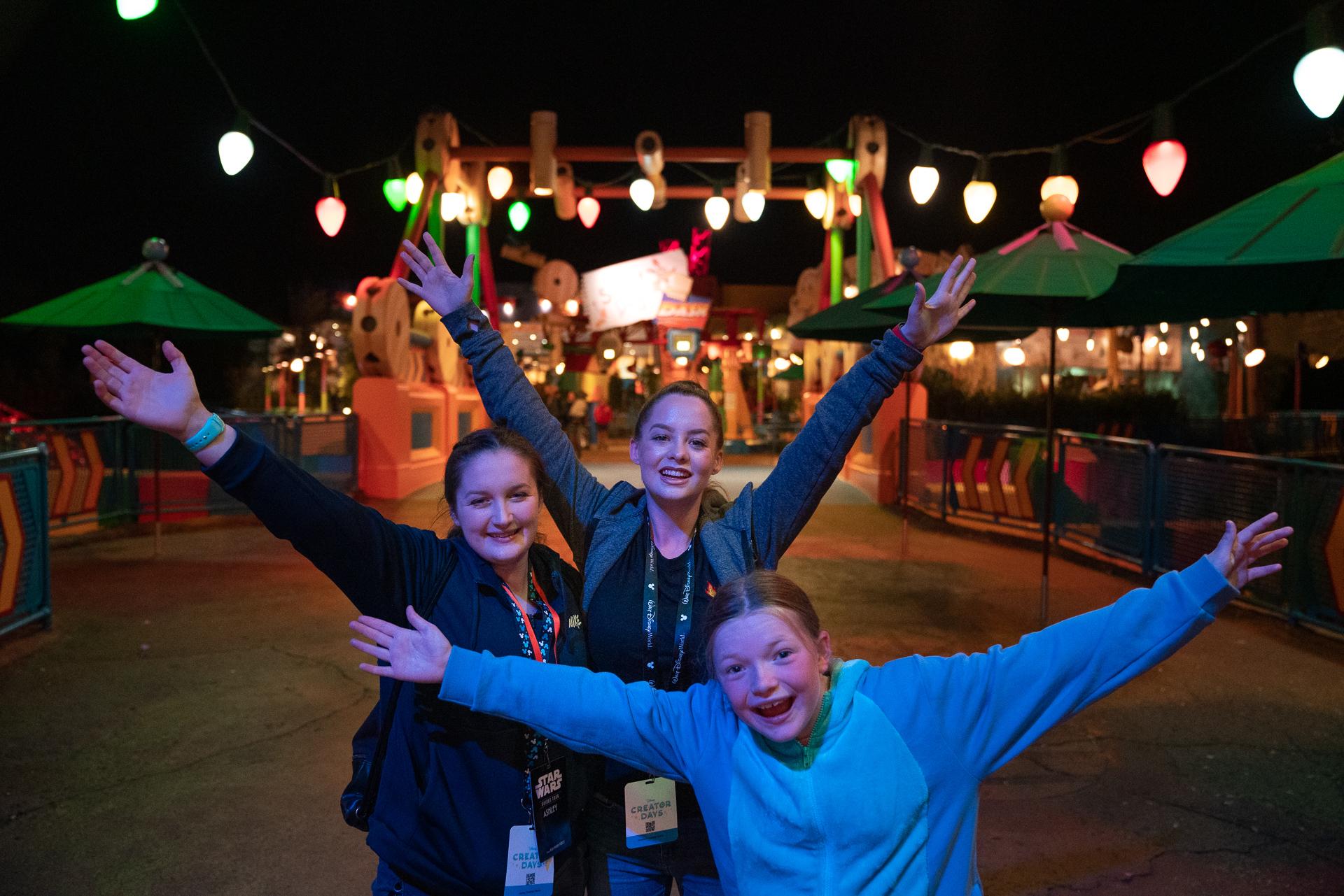 Three girls posing at the entrance to Toy Story Land at Disney's Hollywood Studios at Walt Disney World