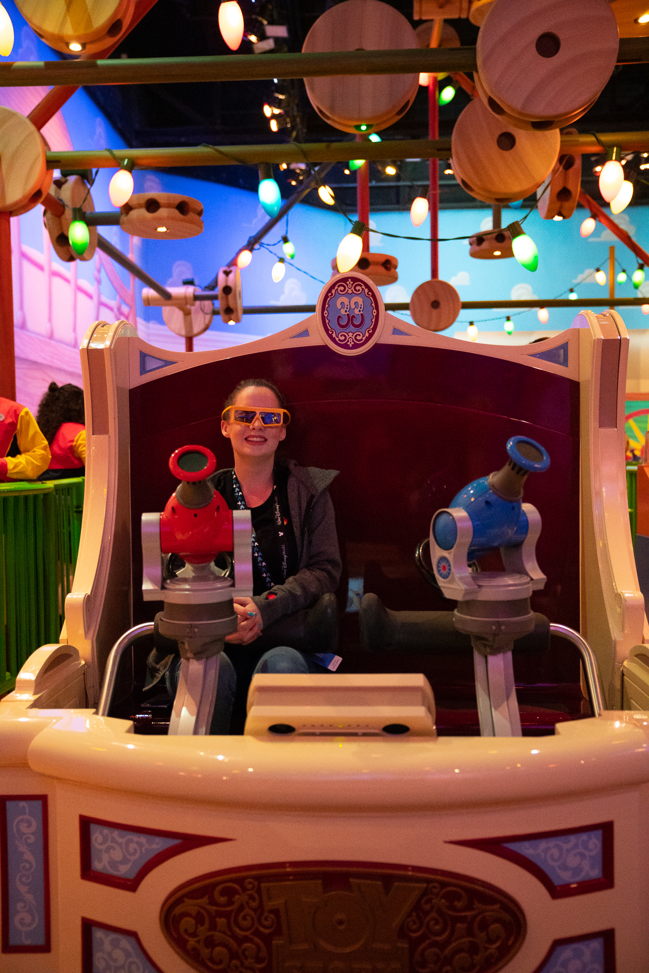 Girl riding Toy Story Midway Mania in Toy Story Land at Disney's Hollywood Studios at Walt Disney World