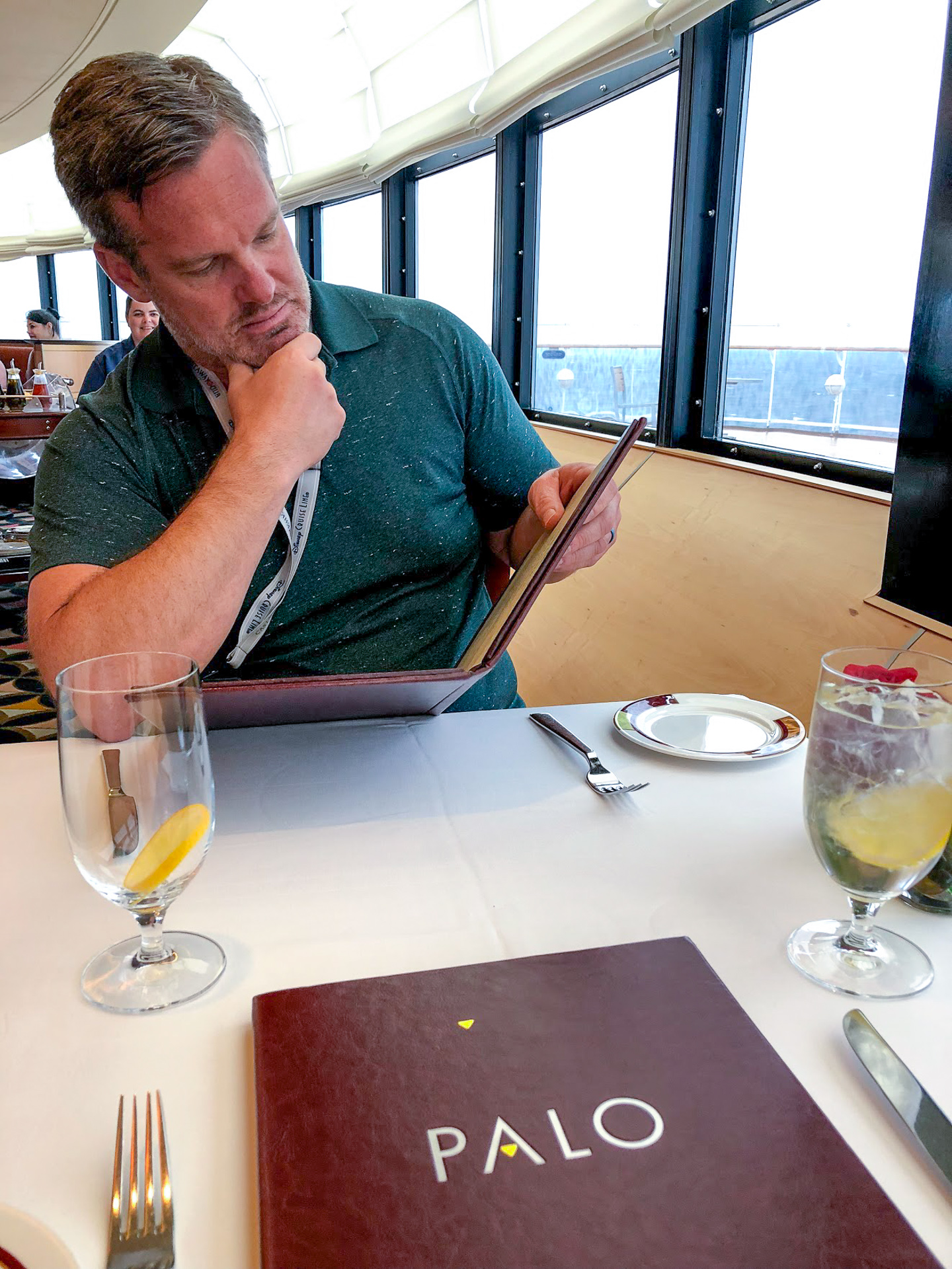 Man looking at the Palo dinner menu on the Disney Dream