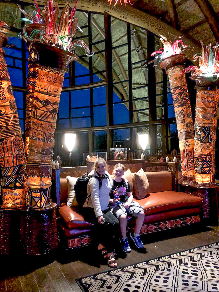 Two girls in the lobby of the Animal Kingdom Lodge at Walt Disney World