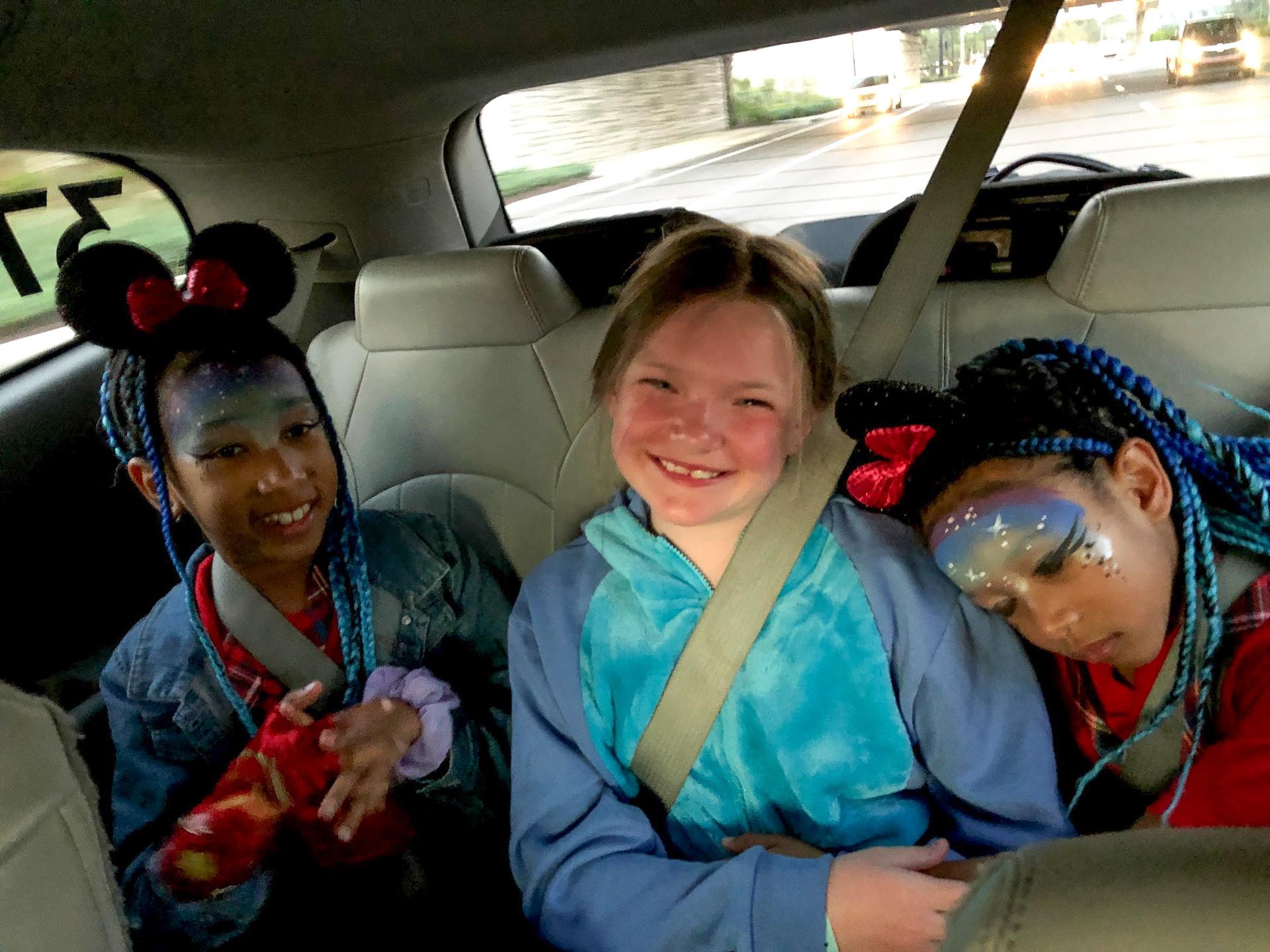 Three girls in a Lyft Minnie Van at Walt Disney World