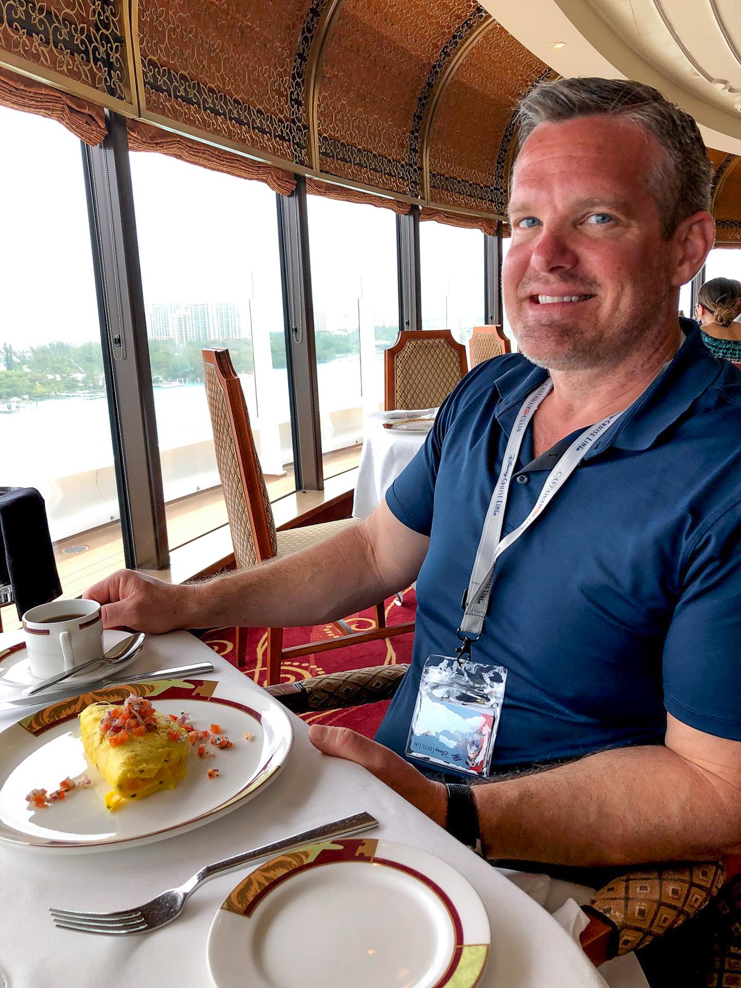 Man eating omelet at Palo brunch on the Disney Dream