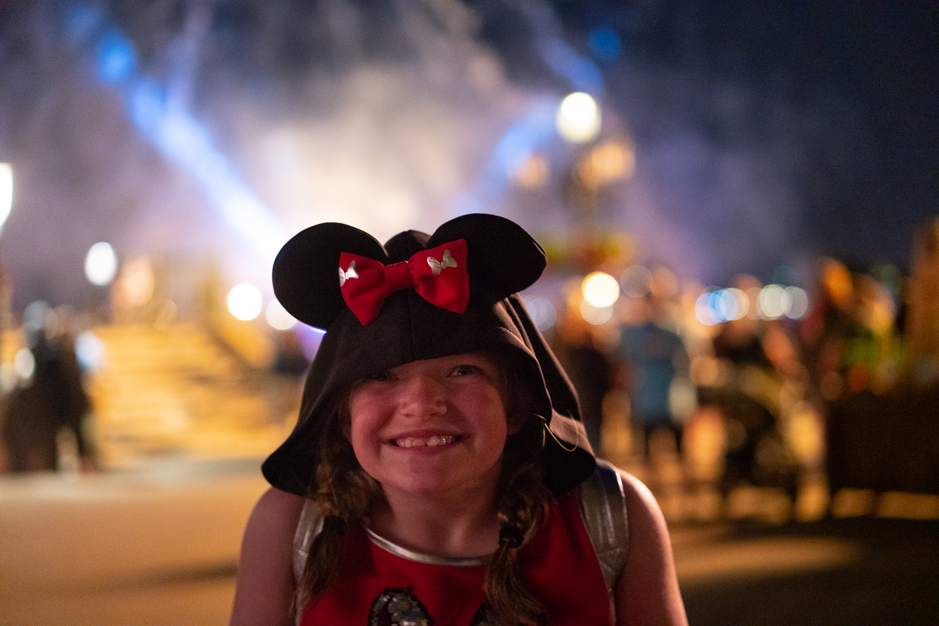 Girl watching IllumiNations: Reflections of Earth at Epcot in Walt Disney World