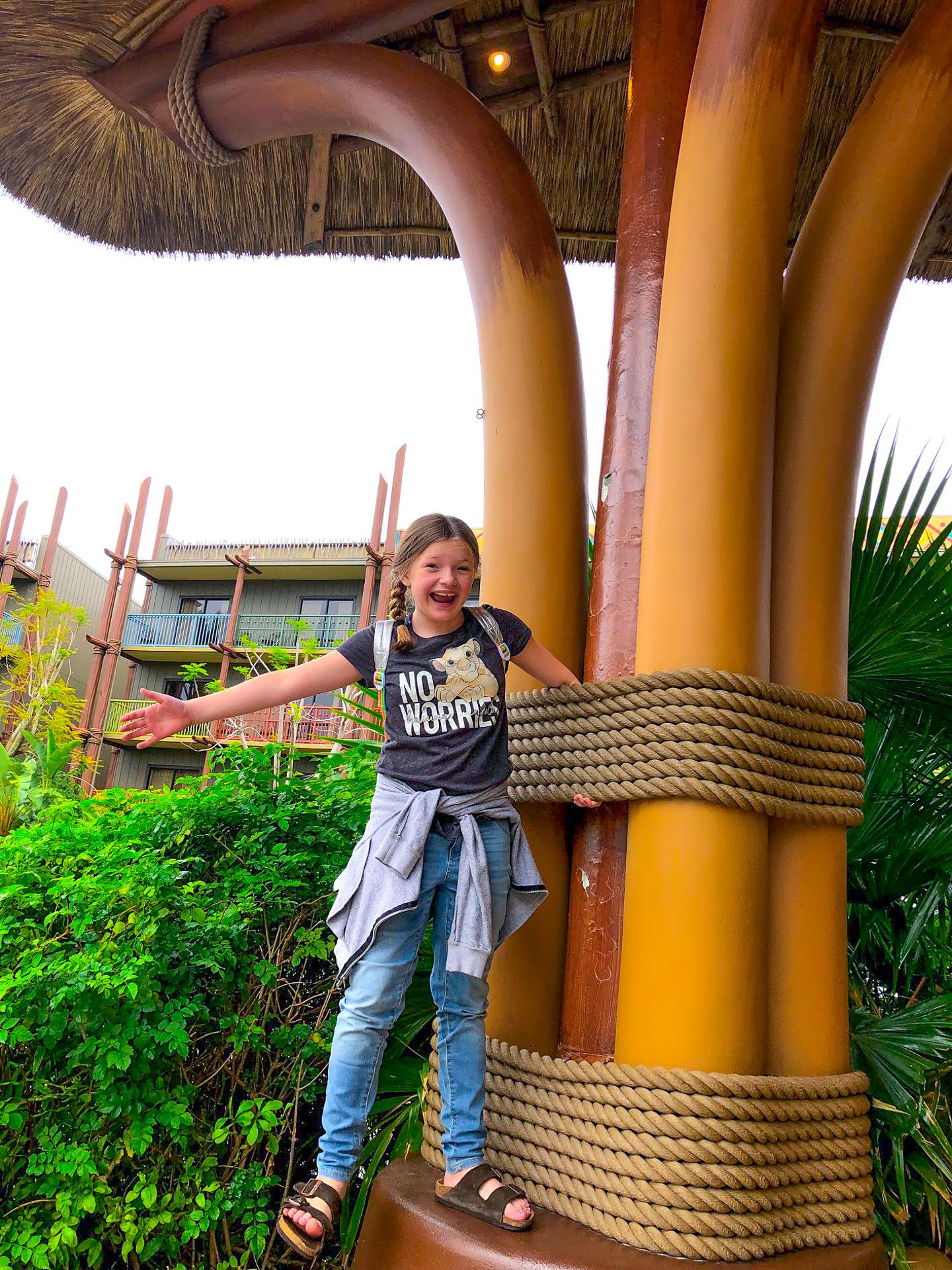Girl standing outside the Animal Kingdom Lodge at Walt Disney World