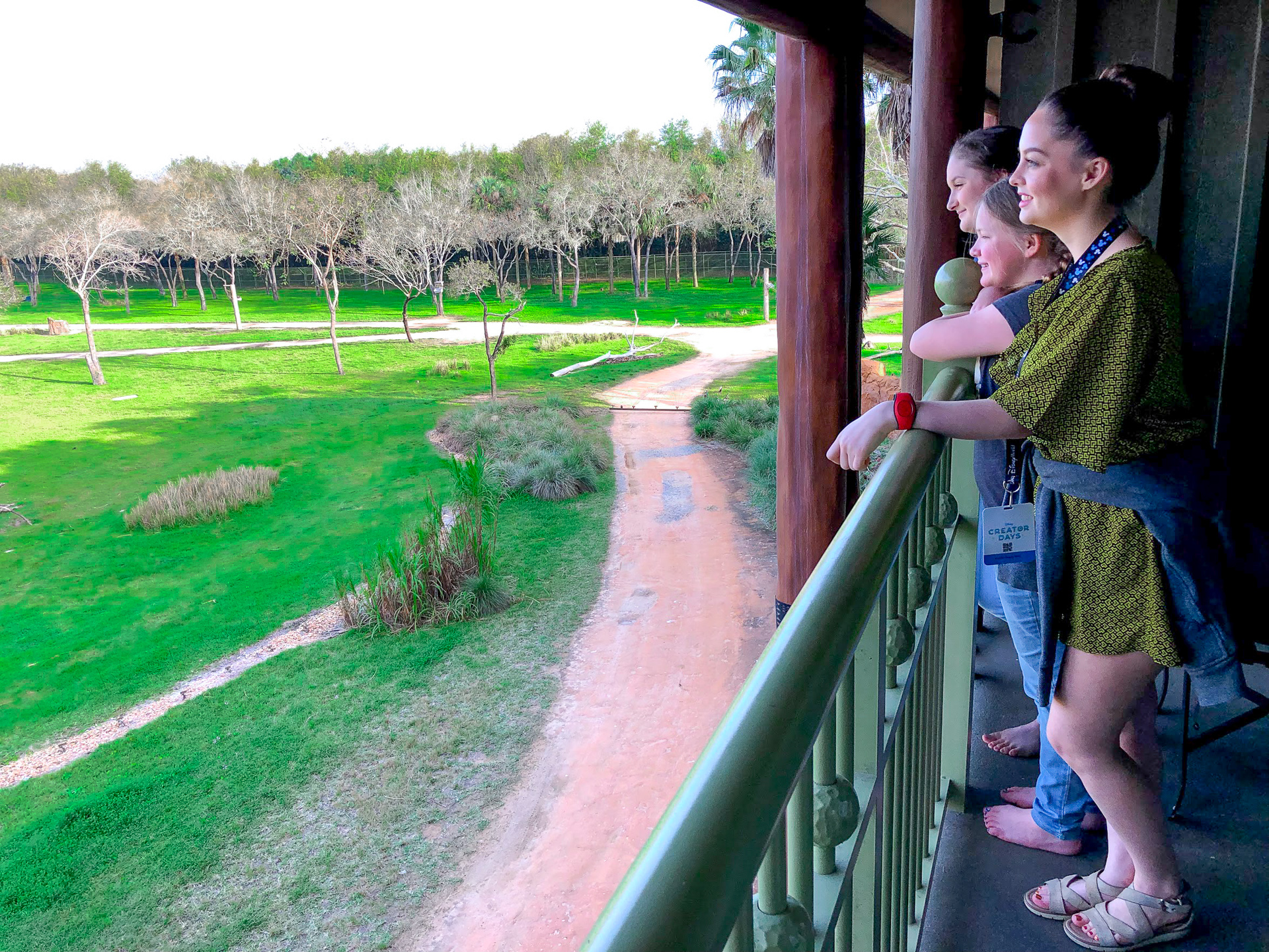 Three girls standing on the balcony of a room at the Animal Kingdom Lodge at Walt Disney World