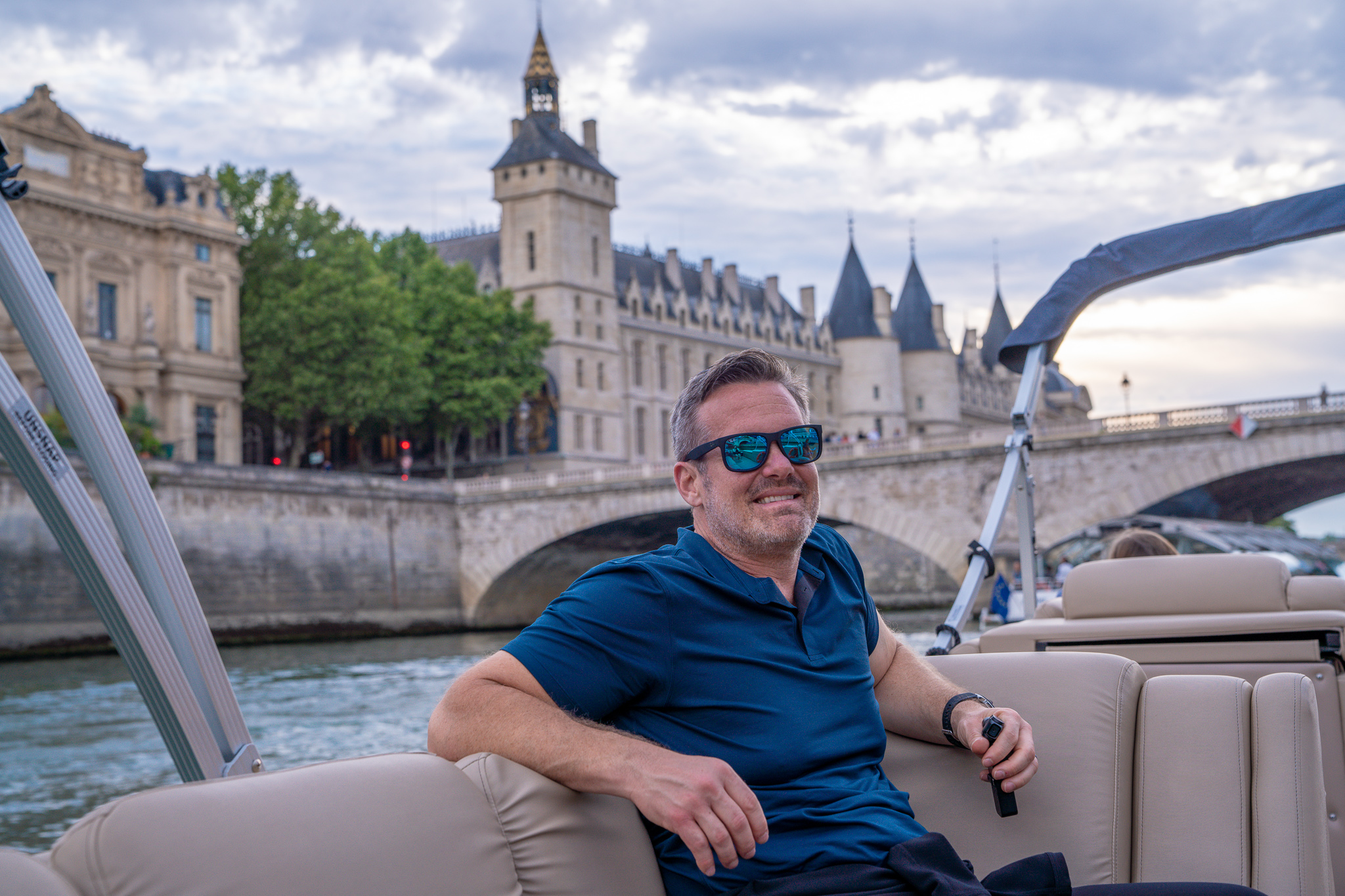 Man sitting in a private boat cruising the Seine river in Paris, France