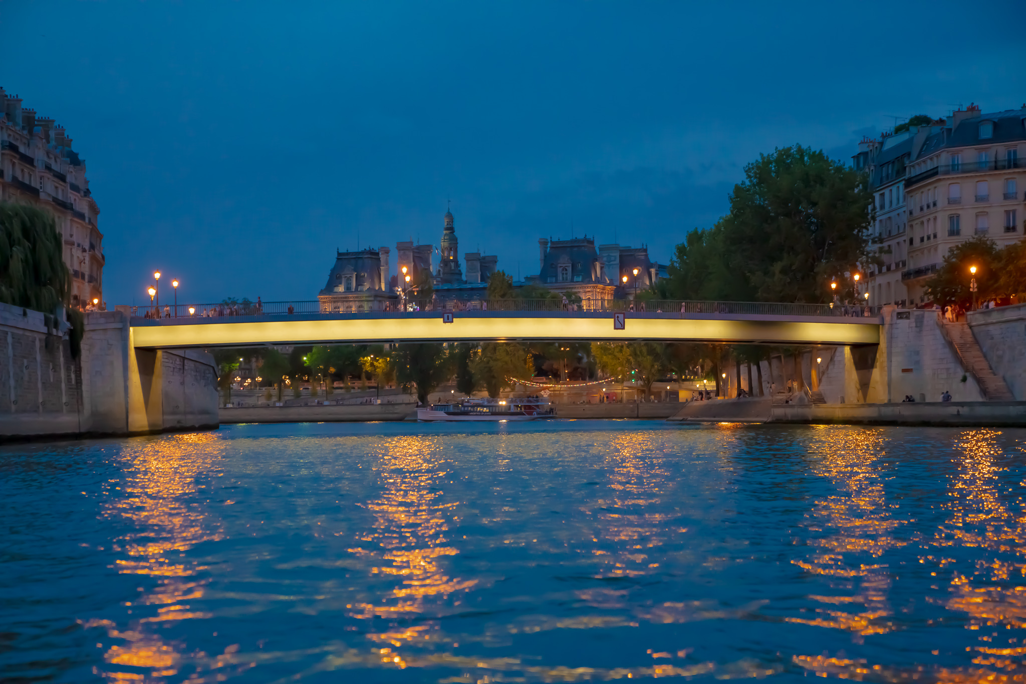 A bridge over the Seine river at twilight in Paris, France