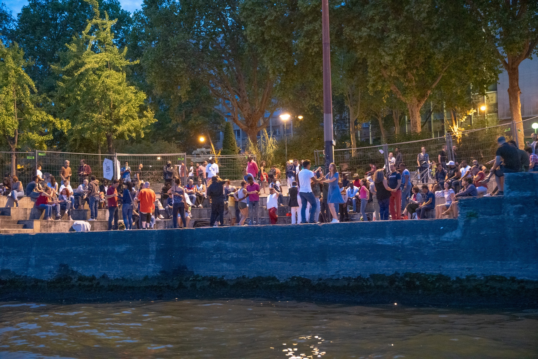 Dancing on the banks of the Seine river in Paris, France