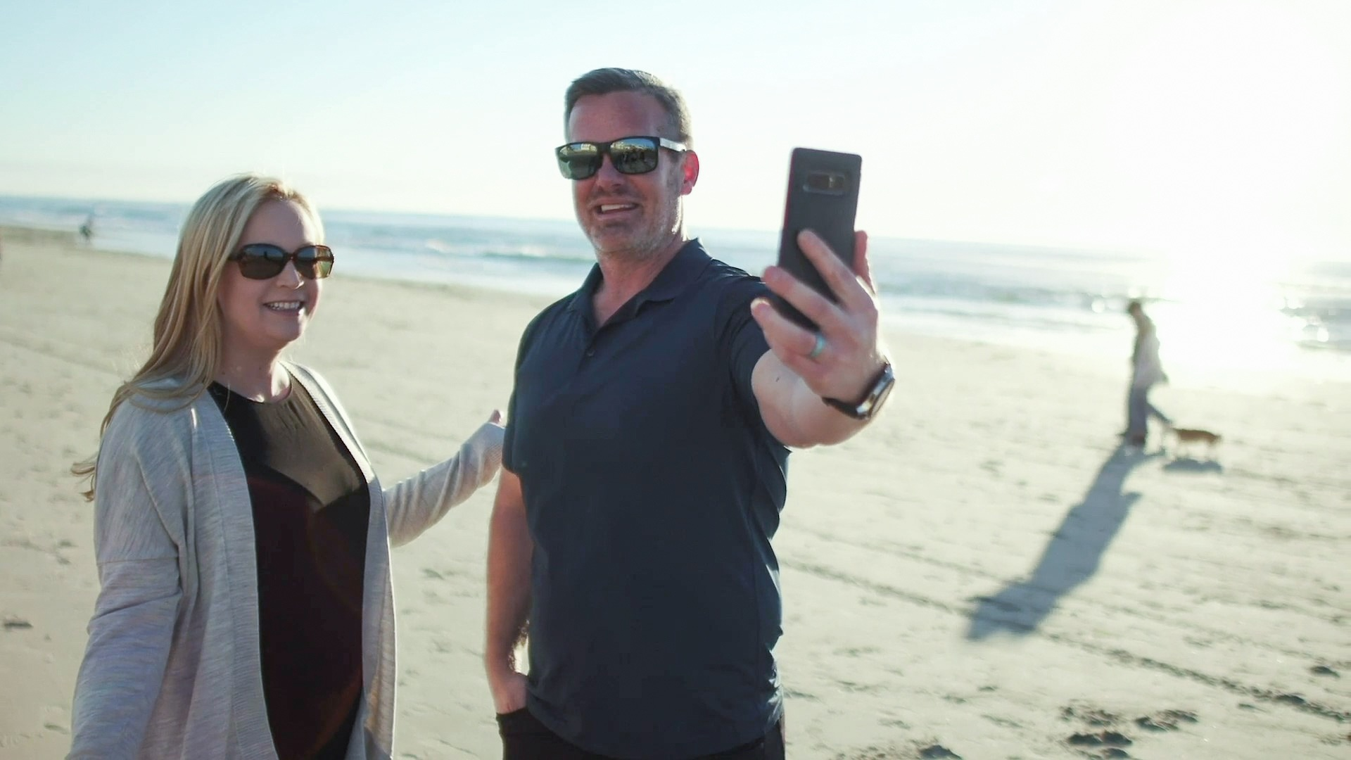 Pete and Heather Reese make a live video on the beach